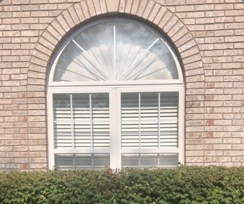 Half Round Window with Set of Double Hung Windows Below